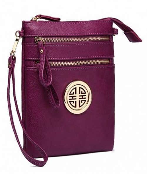 Malá fialová kožená kabelka s poutkem pro držení v ruce